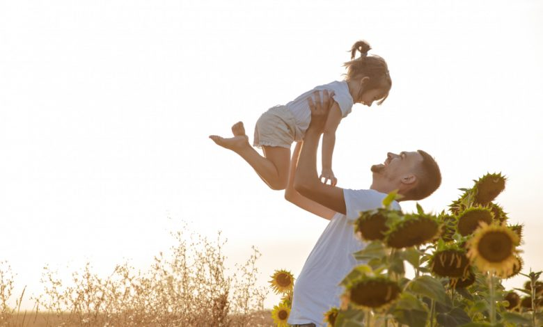 happy-family-father-daughter-playing-field