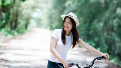 young-beautiful-woman-riding-bicycle-park