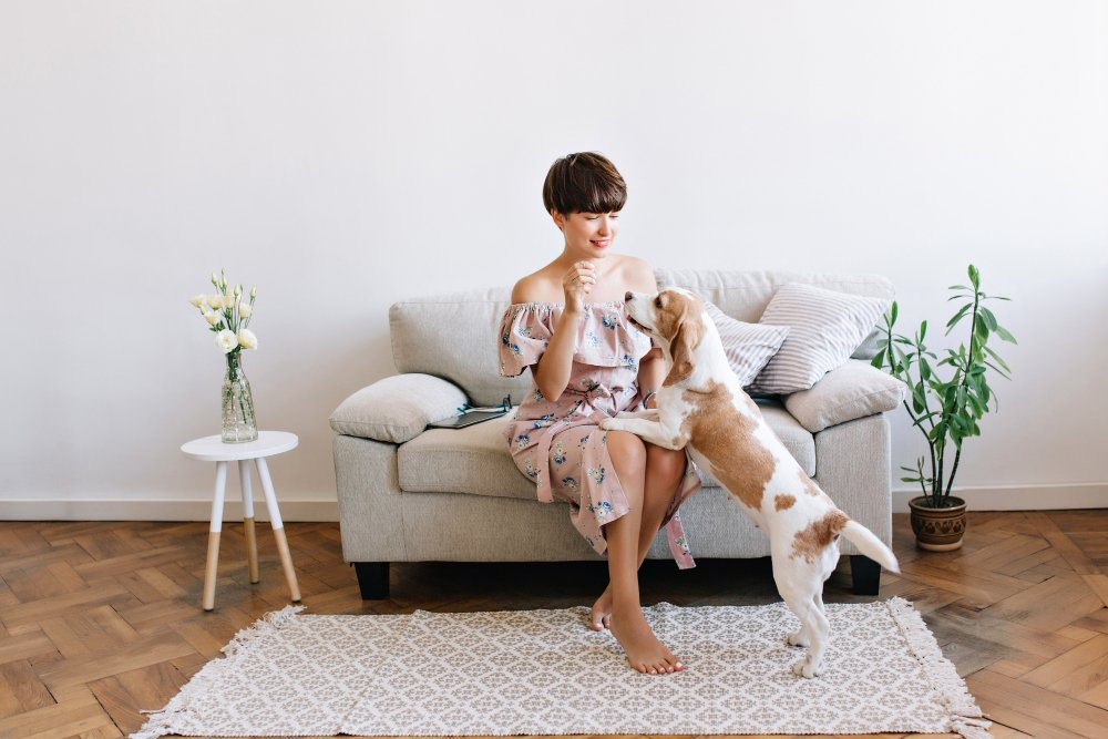 Woman with dog in living room