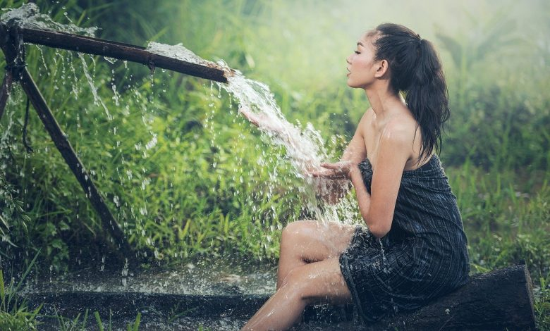 Woman cleaning body outdoor